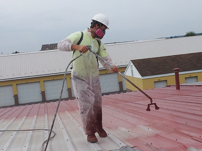 Contractor Applies Metal Roof Coating