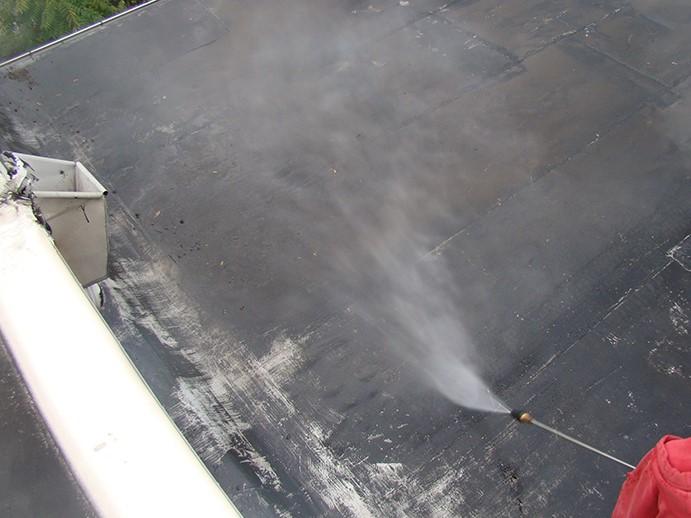 Contractor Coats EPDM Roof