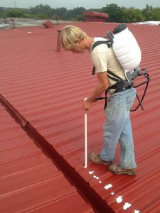 Contractor Coats Metal Roofing