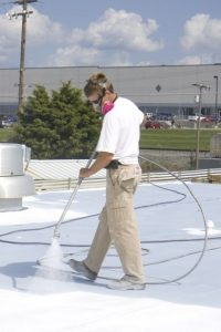Contractor Coats Roof With SPF Spray Foam