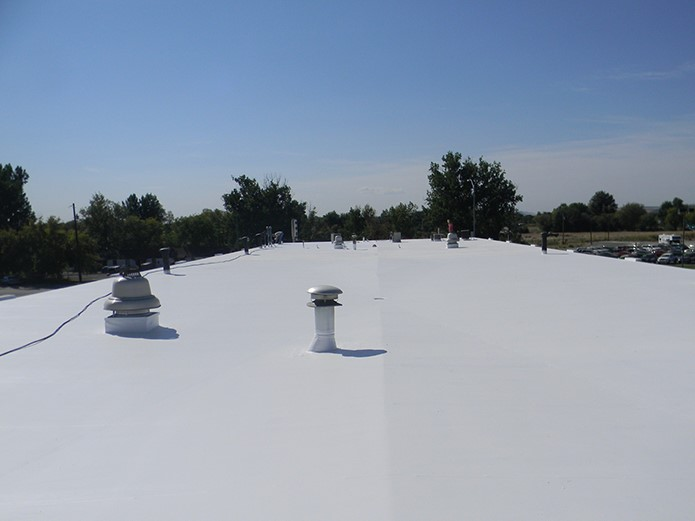 Contractor Performs Commercial Roof Inspection