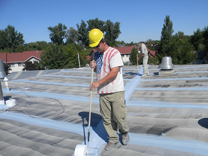 Contractor Performs Fresh Roof Coating