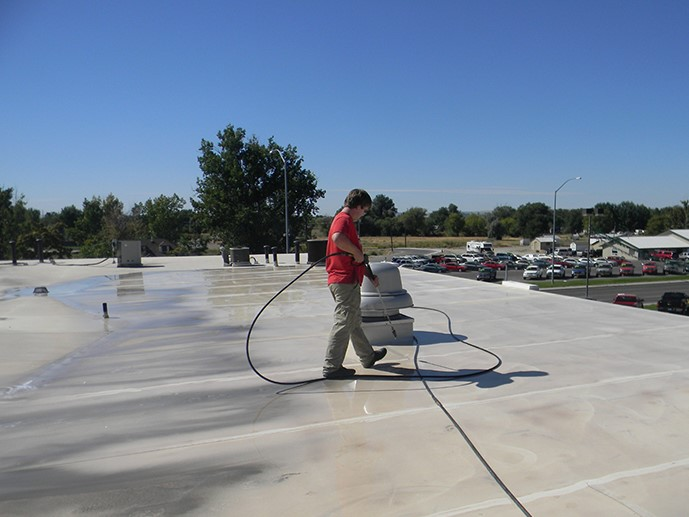 Contractor Working on Roof Installation