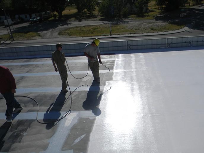 Contractors Apply Acrylic Coating