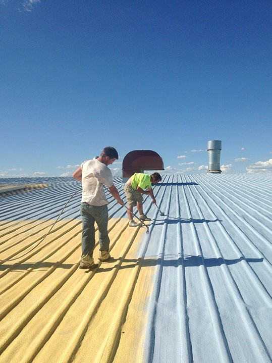 Contractors Work on Industrial Roof