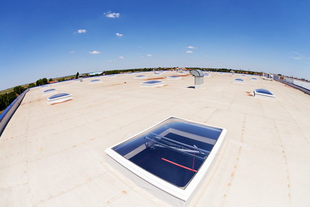 A Flat Commercial Roofing System on a Large Industrial Building