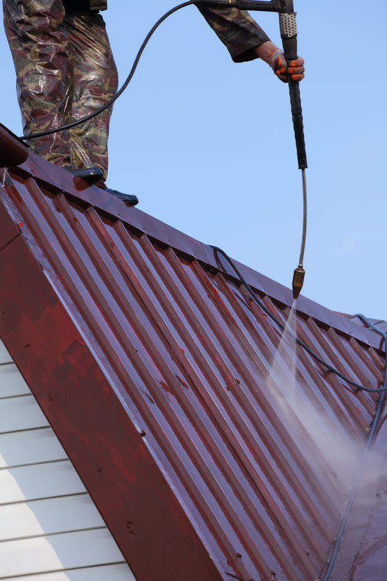 Commercial Roofing Company Cleans a Metal Roof