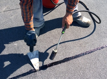 Roofer Fixing Modified Bitumen Material