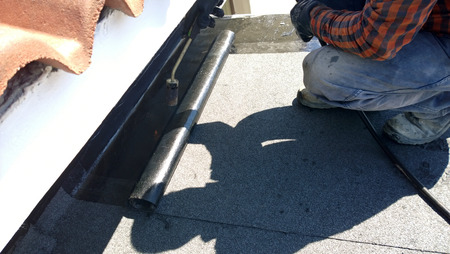 Rolling Out a Commercial Flat Roofing System