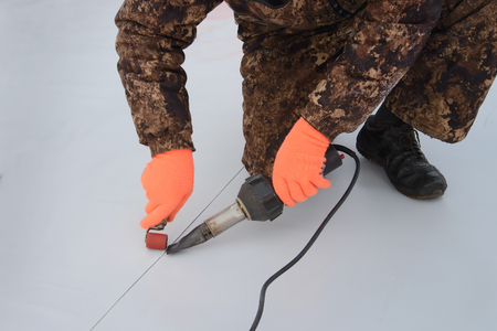 Roofer Installing Vulcanized Rubber